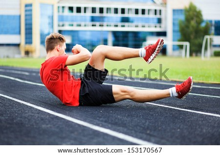 spotrsmen warming up before a run. - stock photo