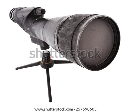 Spotting scope on a tripod that is covered with frost - stock photo