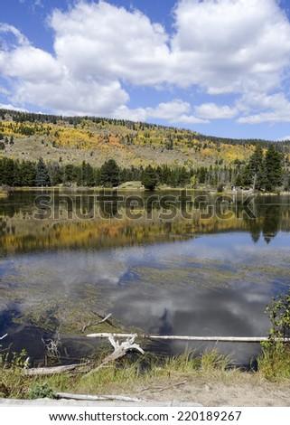 Sprague Lake Autumn Reflection in Rocky Mountain National Park Colorado - stock photo