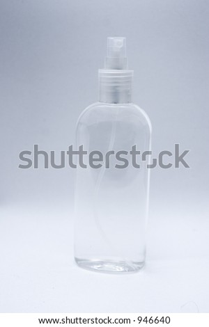Spray bottle made of transparent plastic used; white background. Use it to place your own label. - stock photo