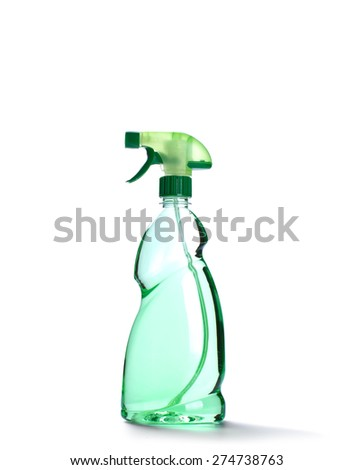 Spray bottle with green liquid isolated on white - stock photo
