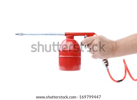 Spray gun and hand isolated. Isolated on a white background. - stock photo