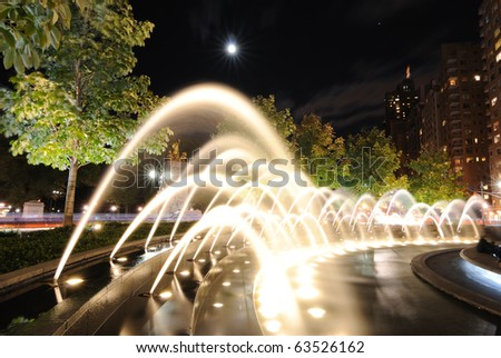 Spray of the fountains at Columbus Circle in New york City. - stock photo