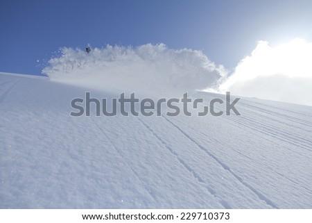 spray snow, freeride in the winter mountains - stock photo