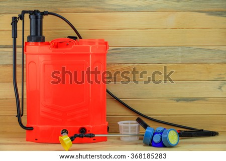 Sprayer and Safety Mask. - stock photo