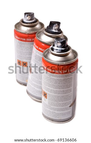 Spraypaint aerosol cans isolated on a white background. - stock photo