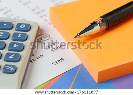 Spreadsheet and graph with pen,pad and calculator - stock photo