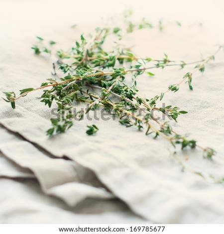 Sprigs of thyme on sack, salubrious herb, toned - stock photo