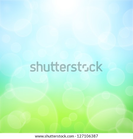 Spring abstract background with bokeh and sun rays. Grass and blue sky - stock photo