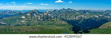 Spring at Top of Colorado Rockies - A panoramic view of rolling high mountains in Front Range of Rocky Mountains, looking west from summit of Mount Bierstadt, 14,065 ft. Colorado, USA. - stock photo