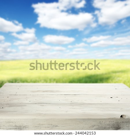 spring background of meadow sky and vintage table of white  - stock photo