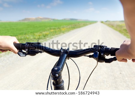 Spring Biking on the field - stock photo