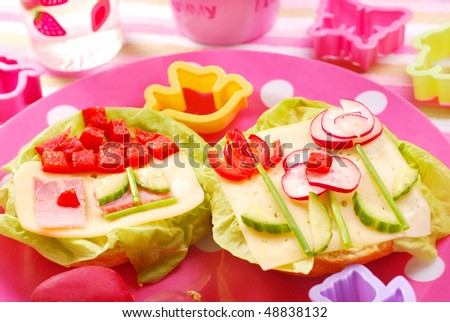 spring breakfast for child with home and  flowers on sandwich - stock photo
