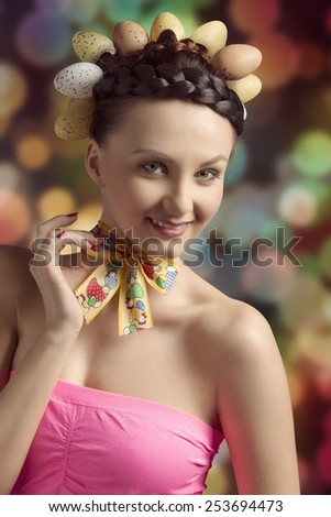 Spring, cheerful, funny, brunette woman with funny egg hairstyle and colorful loop on her neck.  - stock photo