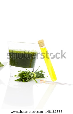 Spring cleaning. Detox. pH test strips, wheat grass and green juice. Natural herbal alternative medicine. Healthy lifestyle.  - stock photo