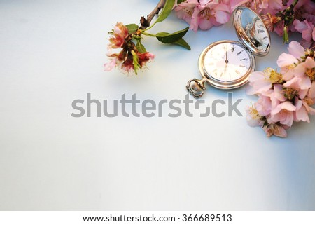 Spring concept. Almond flowers with vintage silver pocket watch. - stock photo