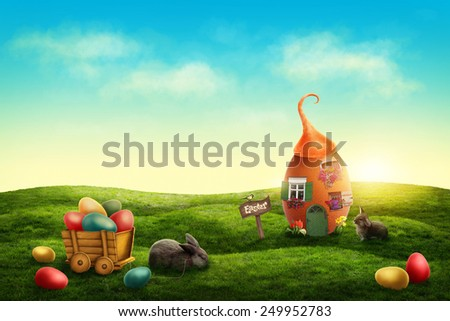Spring easter meadow with egg house and rabbits - stock photo