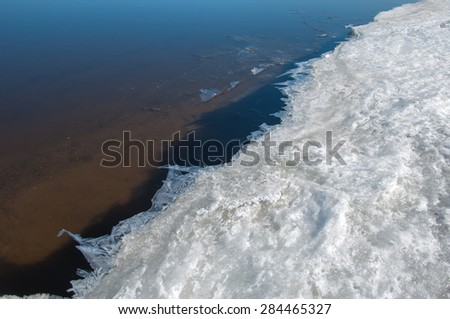 Spring flooding, ice water, Early spring on the river. Russia Tatarstan Kama river in early spring - stock photo