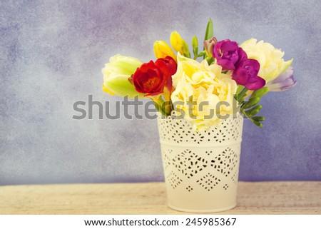 Spring flowers in vase. - stock photo