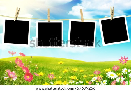 Spring flowers with photos on clothes line - stock photo
