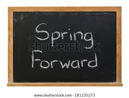 Spring Forward written in white chalk on a black chalkboard isolated on white - stock photo