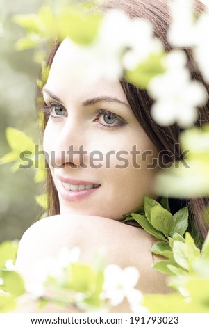 Spring girl with blossom flowers - stock photo