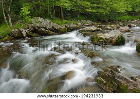 Spring landscape of a cascade and rapids on the Little Pigeon River, Great Smoky Mountains National Park, Tennessee, USA - stock photo