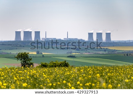 Spring landscape with nuclear power plant on horizon. Czech Republic, Europe. - stock photo