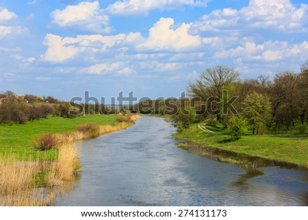 spring landscape with river in forest at spring time - stock photo