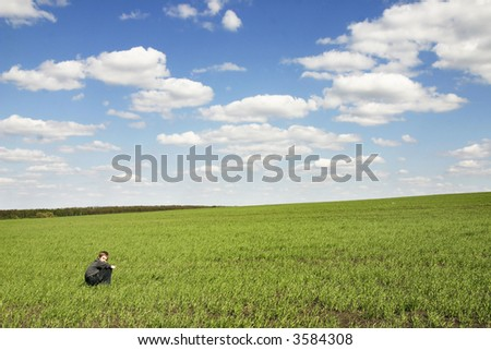 spring landscape with the human figure - stock photo