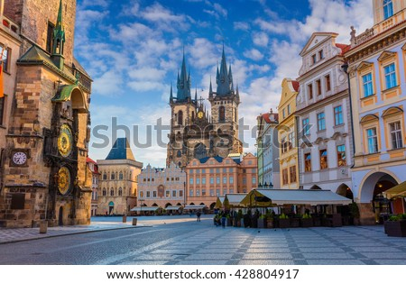 Spring morning on the Old Town square with Tyn Church. Sunny sityscape in capital of Czech Republic - Prague, Europe. Artistic style post processed photo. - stock photo