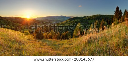 Spring mountain panorama in Slovakia with sun - stock photo