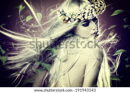 spring nymph with long blond hair in motion and wreath of flowers and leaves around composite photo - stock photo
