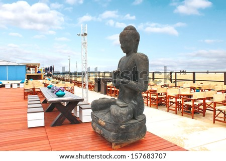 Spring on the coast. The statue in the outdoor cafe at The Hague. Netherlands. den Haag - stock photo
