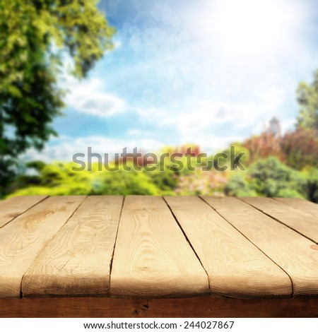 spring or summer background of garden and wooden old table space of free  - stock photo
