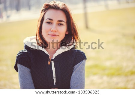 Spring outdoor closeup portrait of young thoughtful woman. - stock photo