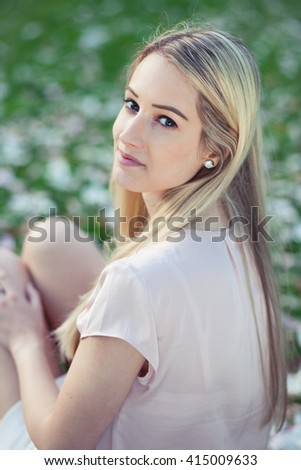 Spring outdoor portrait of a beautiful young woman - stock photo