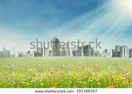 Spring park and modern city. Shot outdoors at spring time - stock photo