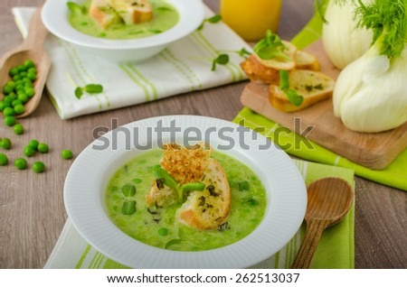 Spring peas soup, beautiful composition, 2 soups, one focus, juice and fennel - stock photo