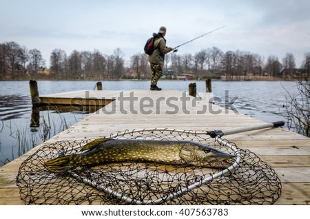 Spring pike fishing - stock photo