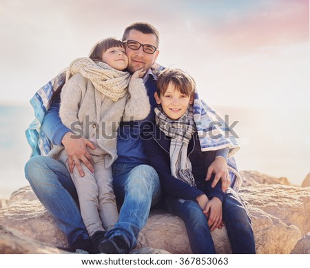 Spring portrait of happy family outdoors - stock photo