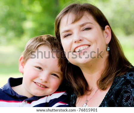 Spring portrait of mother and son on Mother's Day. - stock photo