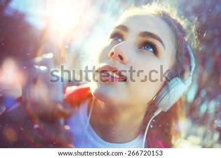 Spring portrait of the girl headphones music player concept - stock photo