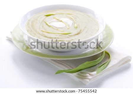 Spring ramson soup in bowl on white background - stock photo