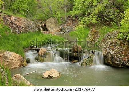 Spring river in the Utah mountains, USA. - stock photo