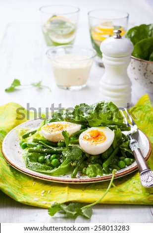 Spring salad with green beans,pea and eggs. - stock photo