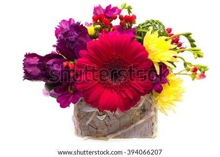 Spring, summer floral arrangement for the wedding , favorite , friend , a gift of flowers gerbera , hypericum , tulips , chrysanthemums in a  pot on a white background . Isolated  - stock photo