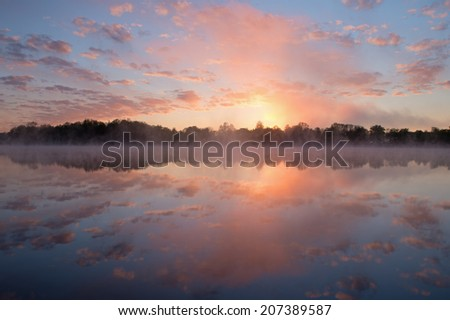 Spring sunrise Whitford Lake in light fog, Fort Custer State Park, Michigan, USA  - stock photo