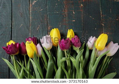spring tulip bouquet on old boards, top view - stock photo