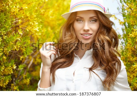 Spring woman in summer day walking in yellow park  - stock photo